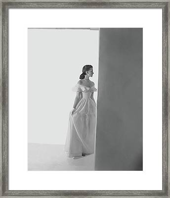Bethel Leslie Wearing An Off-the-shoulder Dress Framed Print by Horst P. Horst