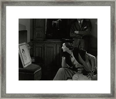 Betty Mclauchlen Looking At An Illustration Framed Print by Edward Steichen