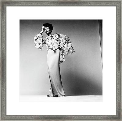 Beverly Johnson Wearing A Dress And Chiffon Framed Print by Francesco Scavullo