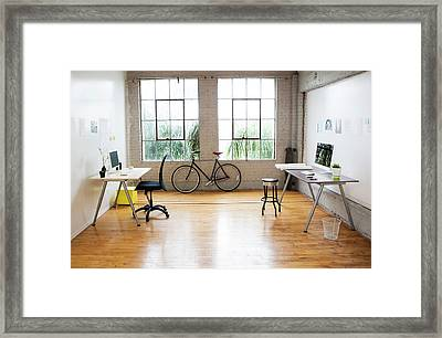 Bicycle And Desks In Modern Office Framed Print by Sam Diephuis