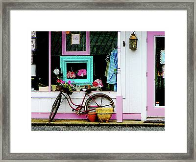 Bicycle By Antique Shop Framed Print