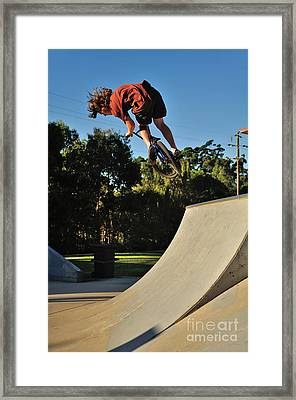 Bicycle In Flight - Action Framed Print by Kaye Menner
