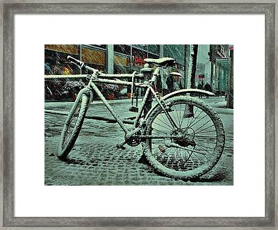 Bicycle In The Snow Framed Print by Marco Oliveira
