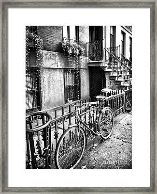 Bicycle In The Village Framed Print by John Rizzuto