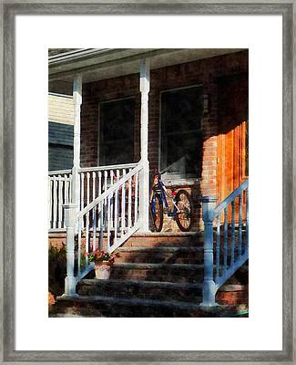 Bicycle On Porch Framed Print by Susan Savad