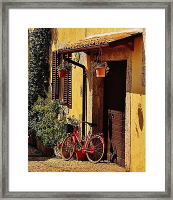 Bicycle Under The Porch Framed Print by Dany Lison