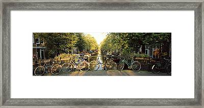 Bicycles On Bridge Over Canal Framed Print by Panoramic Images