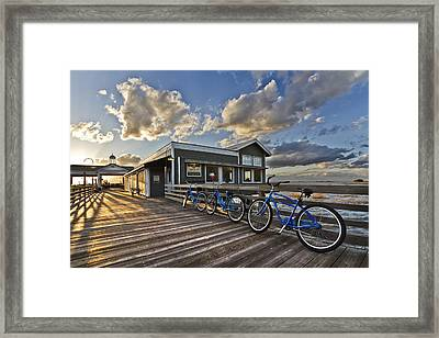 Bicycles On The Dock Framed Print by Debra and Dave Vanderlaan