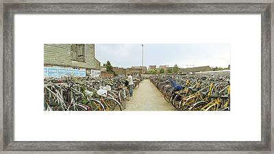 Bicycles Parked In The Parking Lot Framed Print