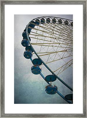 Big Wheel In Blue Framed Print by Jaroslaw Blaminsky