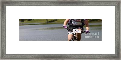 Bike By Woman Framed Print by Steven Digman