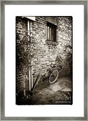 Bike In Pirates Alley Framed Print by John Rizzuto