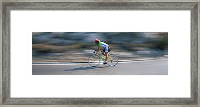 Bike Racer Participating In A Bicycle Framed Print by Panoramic Images