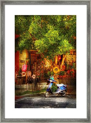 Bike - Scooter - Sitting Amongst Urban Flowers Framed Print
