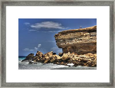 Framed Print featuring the photograph Biker On The Rocky Cliff At La Pared by Julis Simo