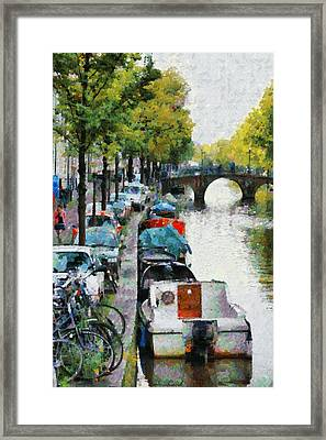 Bikes And Boats In Old Amsterdam Framed Print