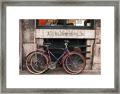 Bikes In Old Montreal Framed Print by John Rizzuto