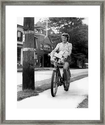 Biking To Get Groceries Framed Print by Underwood Archives