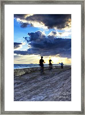 Biking To The Sun Framed Print by Eyzen M Kim