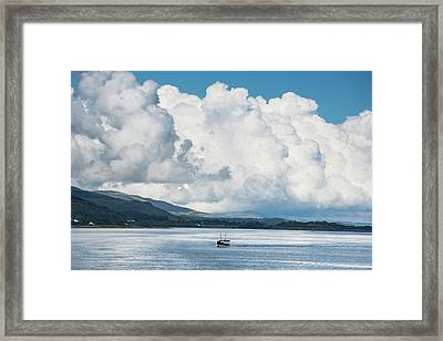 Billowing Cloud And A Boat In The Ocean Framed Print by John Short