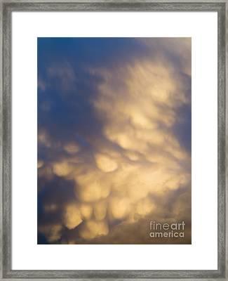 Bizarre Clouds Framed Print