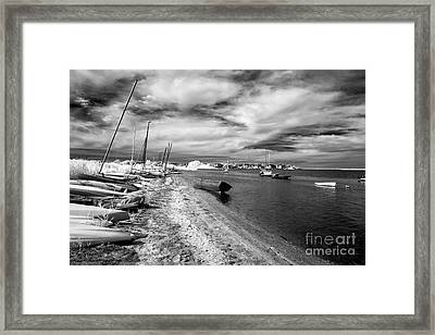 Black Boat In The Water Framed Print