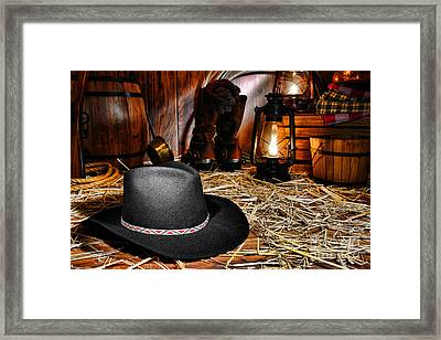 Black Cowboy Hat In An Old Barn Framed Print by Olivier Le Queinec