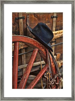 Black Hat On A Red Wagon Wheel Framed Print