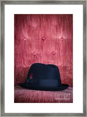 Black Hat On Red Velvet Chair Framed Print by Edward Fielding