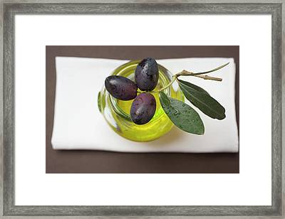 Black Olives On Twig On Glass Of Olive Oil Framed Print