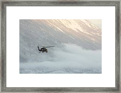 Blackhawk In The Mountains Framed Print by Tim Grams