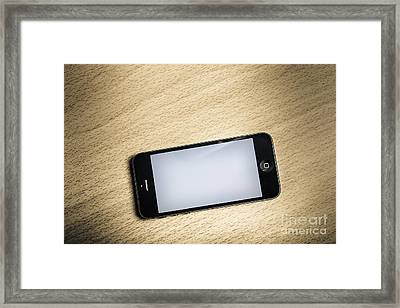 Blank Smart Phone On Wooden Office Desk Framed Print by Jorgo Photography - Wall Art Gallery