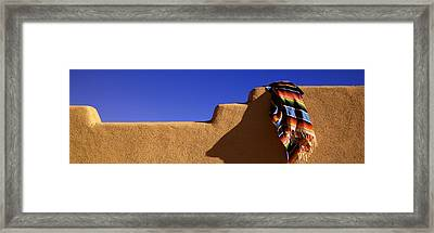 Blanket Lying On The Wall Framed Print by Panoramic Images