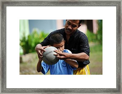 Blind Boy With Football Framed Print by Matthew Oldfield