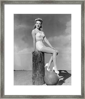 Blonde On A Piling Framed Print by Underwood Archives