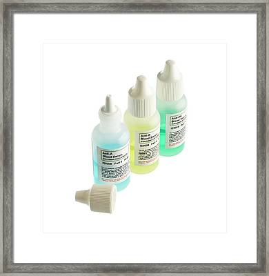 Blood Serum Samples In Plastic Bottles Framed Print
