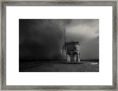 Blowing Away The Darkness Framed Print by Chris Fletcher
