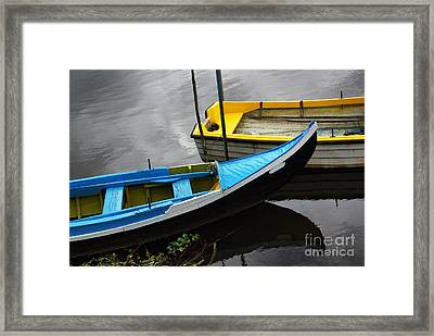 Blue And Yellow Boats Framed Print