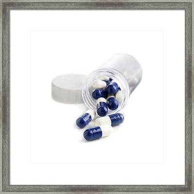 Blue And White Capsules In A Container Framed Print