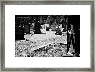 Blue And White Statue Of Our Lady The Virgin Mary Praying Sitting On Top Of Grave In The Graveyard Of Glendalough Monastic Site Framed Print