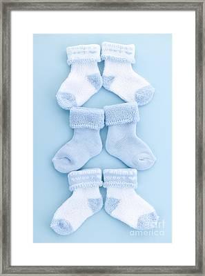 Blue Baby Socks Framed Print