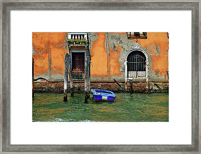 Blue Boat Tied To A Piling. Framed Print by James David Phenicie