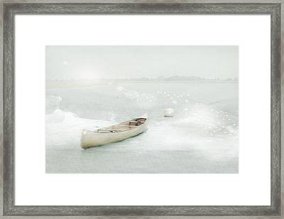 Blue Canoe Framed Print