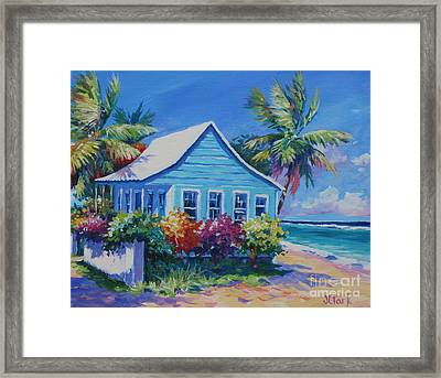 Blue Cottage On The Beach Framed Print by John Clark