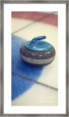 Blue Curling Stone Framed Print by Priska Wettstein