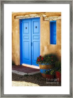 Blue Door Adobe Walls Framed Print by George Oze