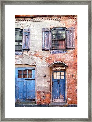 Blue Door Red Wall Framed Print