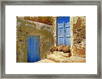 Blue Doors Of Santorini Framed Print by Madeline Ellis
