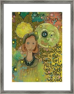 Blue-eyed Moon Framed Print