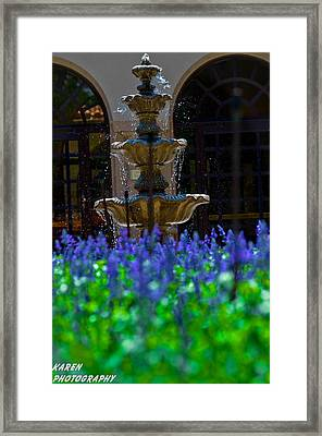 Blue Flowers And A Fountain Framed Print